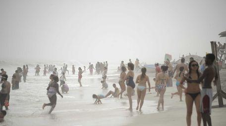 Beachgoers at Jones Beach's Field 6 make the