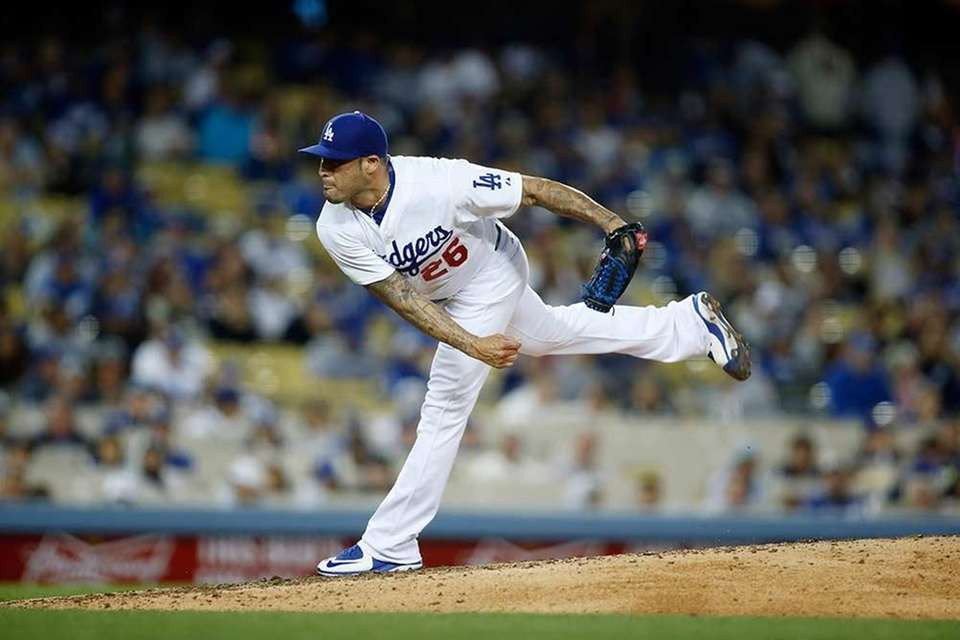 Reliever for Dodgers, then Yankees in 2015.