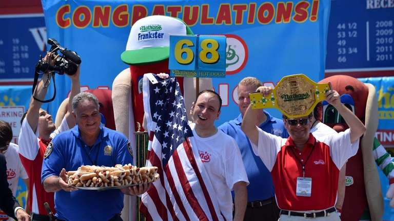 Five-time Nathan's Famous Champion Joey Chestnut celebrates his