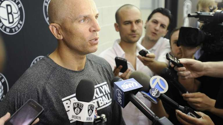 Brooklyn Nets coach Jason Kidd talks with the