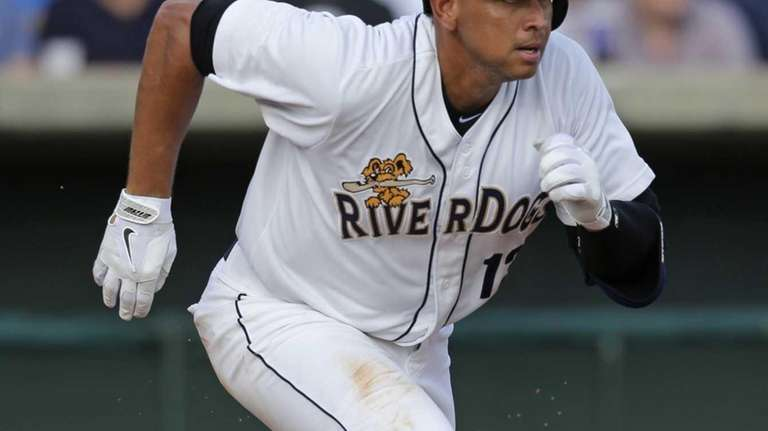 Alex Rodriguez runs to first after making contact