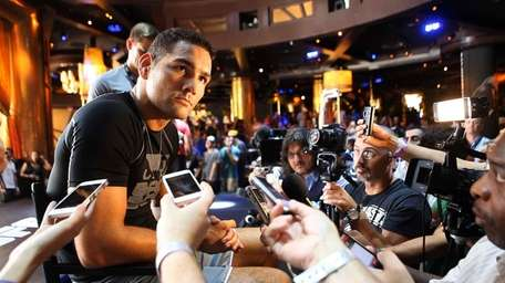 Chris Weidman takes questions from the media. (July