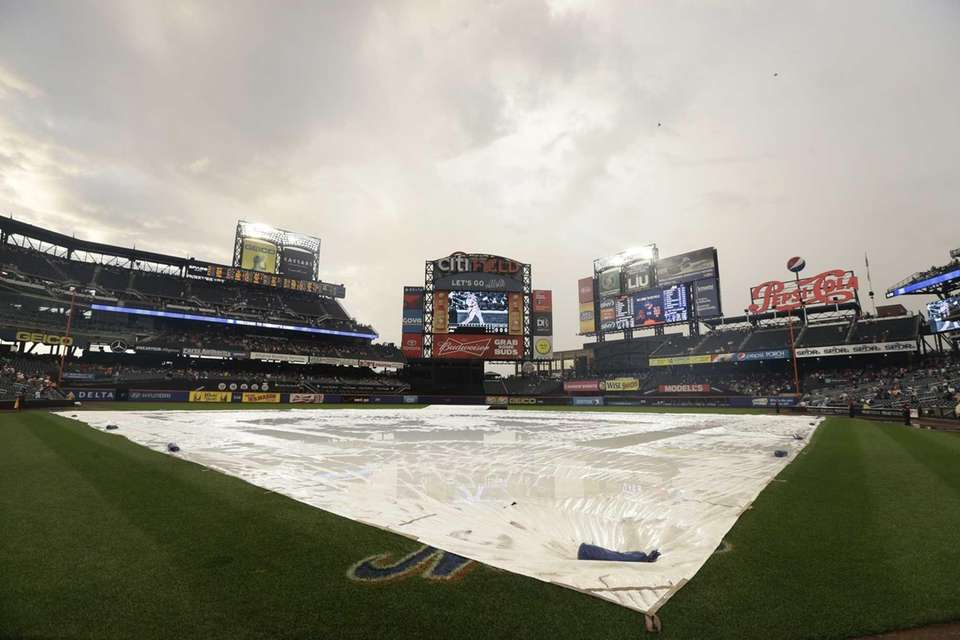 The infield is covered during a rain delay