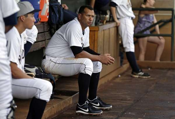Alex Rodriguez sits in the dugout during the