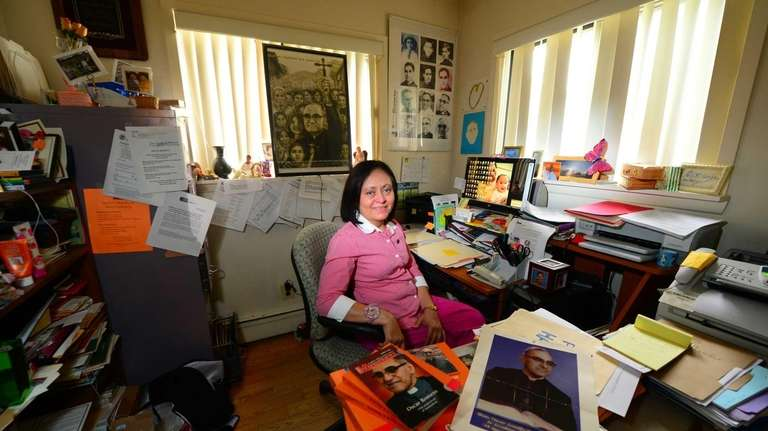 Yanira Chacon-Lopez sits in her office surrounded by