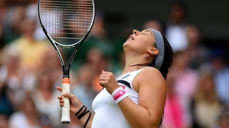 Marion Bartoli of France celebrates victory during the