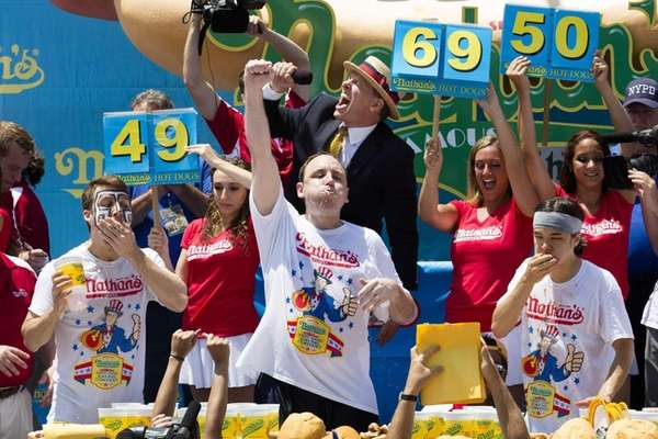 Joey Chestnut, center, wins the Nathan's Famous Fourth