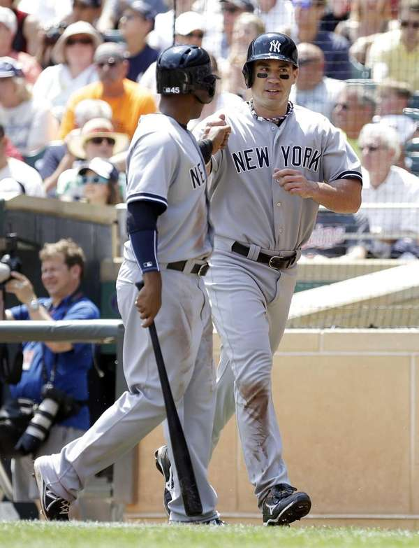 Yankees teammates Zoilo Almonte, left, and Travis Hafner