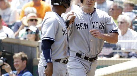 Yankees teammates Zoilo Almonte, left, and Travis Hafner