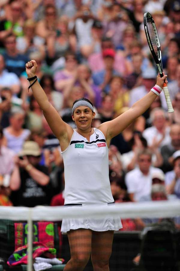 Marion Bartoli celebrates beating Kirsten Flipkens during their