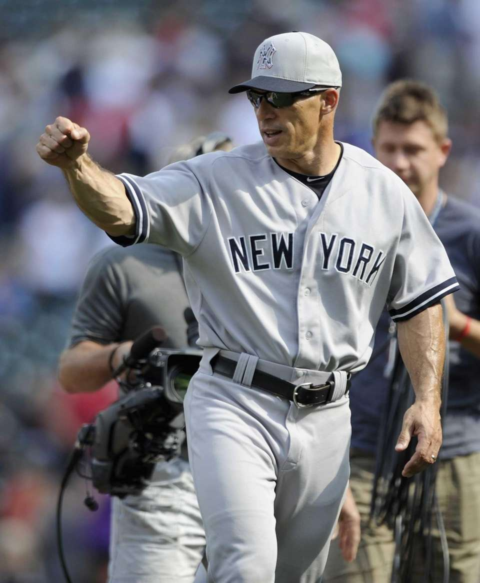 Yankees manager Joe Girardi celebrates a win over