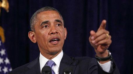 President Barack Obama gestures about the Affordable Care