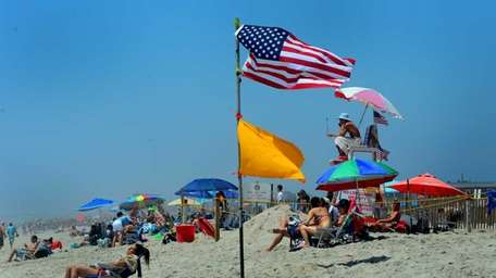 Beachgoers enjoy the Fourth of July holiday on