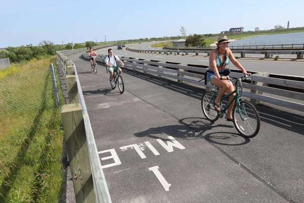 Bike riders on the newly paved bike path