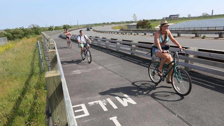 Bike riders on the newly paved bike path