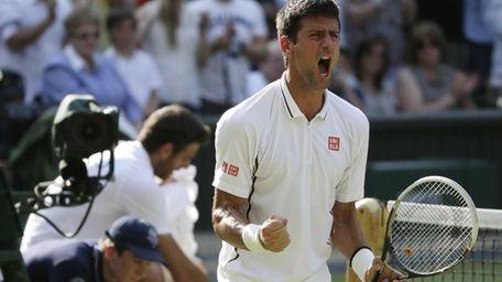 Novak Djokovic of Serbia reacts after defeating Juan