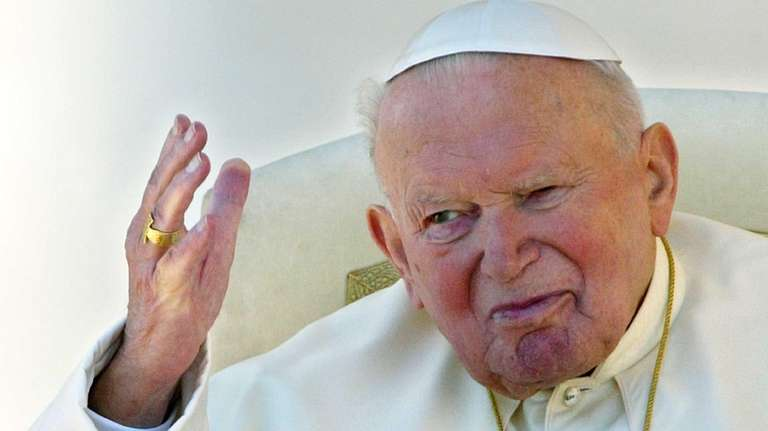 Pope John Paul II blesses the pilgrims gathered
