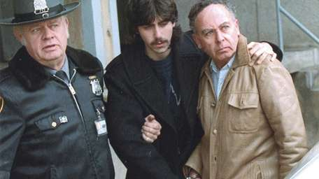 Jesse Friedman, center, and his father, Arnold, right,