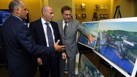 Scott Rechler, center, and Donald Monti, right, have