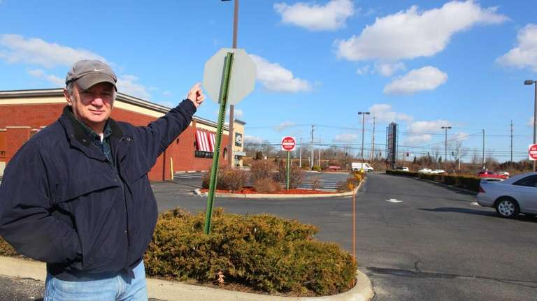 Louis Puglia is concerned about a stop sign