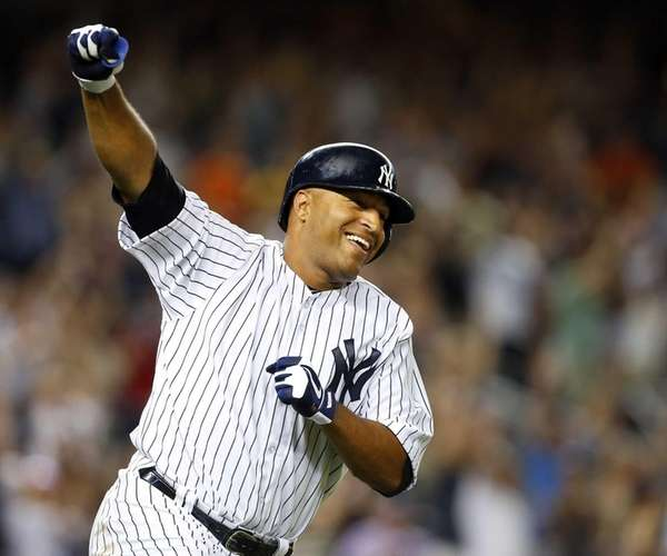 Vernon Wells of the Yankees celebrates his ninth-inning,