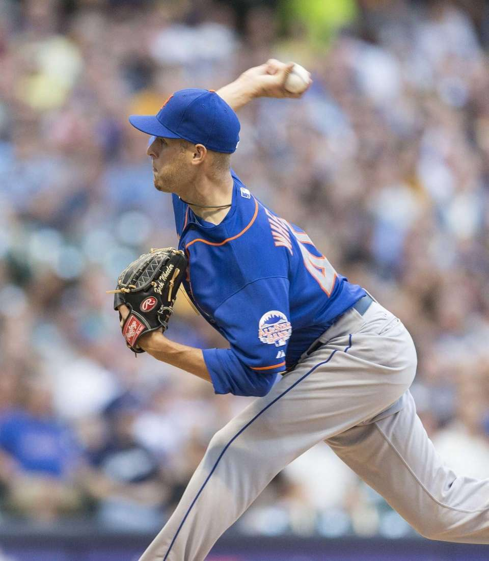 Zack Wheeler of the Mets pitches to a