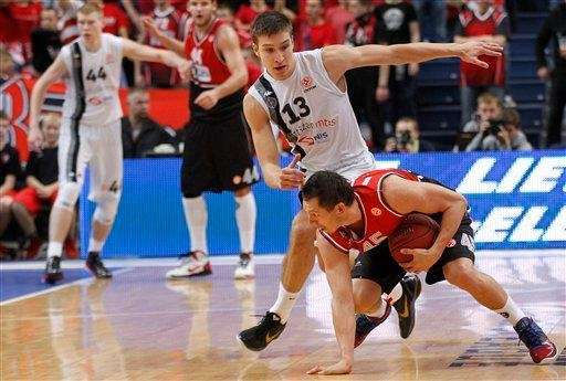 Bogdan Bogdanovic of Serbia's BC Partizan is challenged