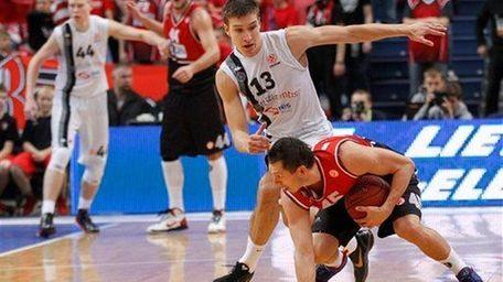 Bogdan Bogdanovic of Serbia's BC Partizan is challenged