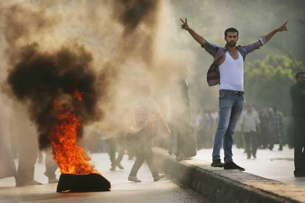 Supporters of former Egyptian President Mohammed Morsi burn
