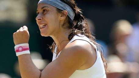 Marion Bartoli of France celebrates a point during