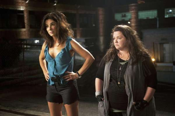 Sandra Bullock, left, as FBI Special Agent Sarah