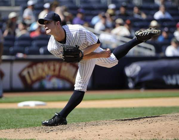 Relief pitcher David Robertson of the Yankees delivers