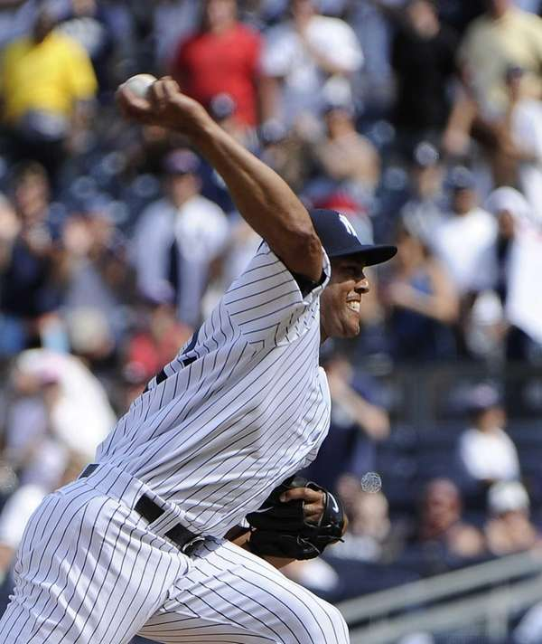 Pitcher Mariano Rivera of the Yankees delivers during