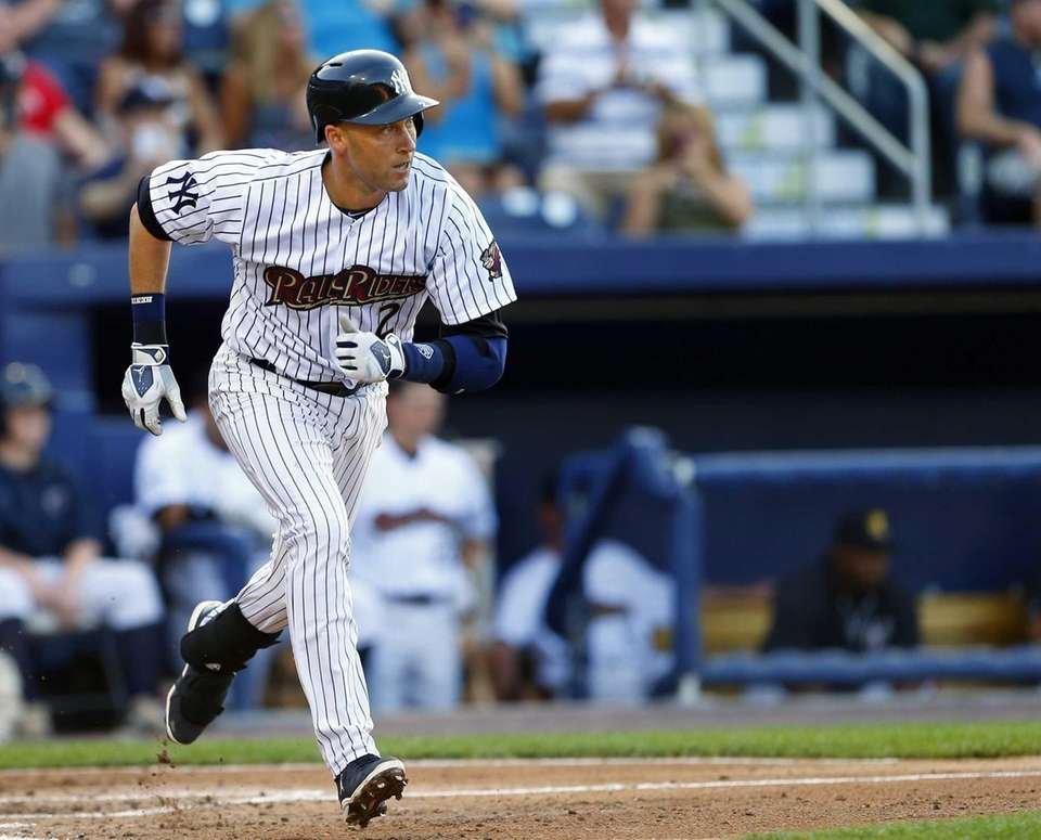 Yankees shortstop Derek Jeter runs to first as