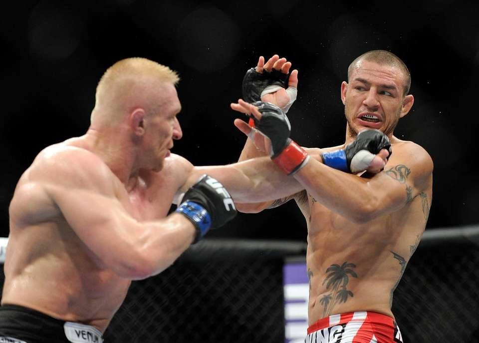 Dennis Siver, left, and Cub Swanson trade punches