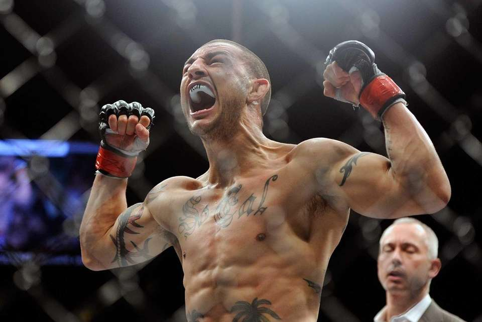Cub Swanson reacts after defeating Dennis Siver during