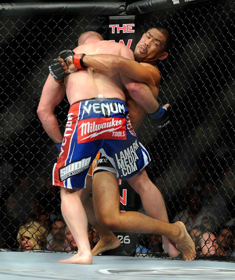 Mark Munoz, right, holds on to Tim Boetsch