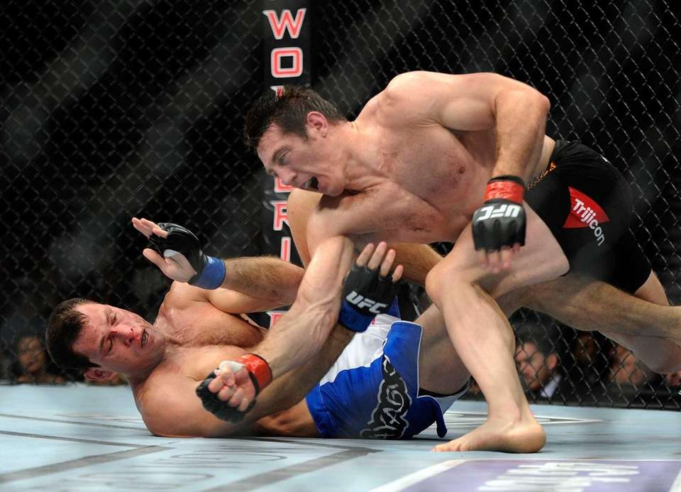 Tim Kennedy punches Roger Gracie during their UFC