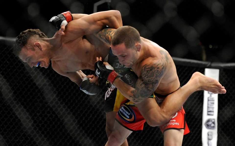 Frankie Edgar throws Charles Oliveira to the mat