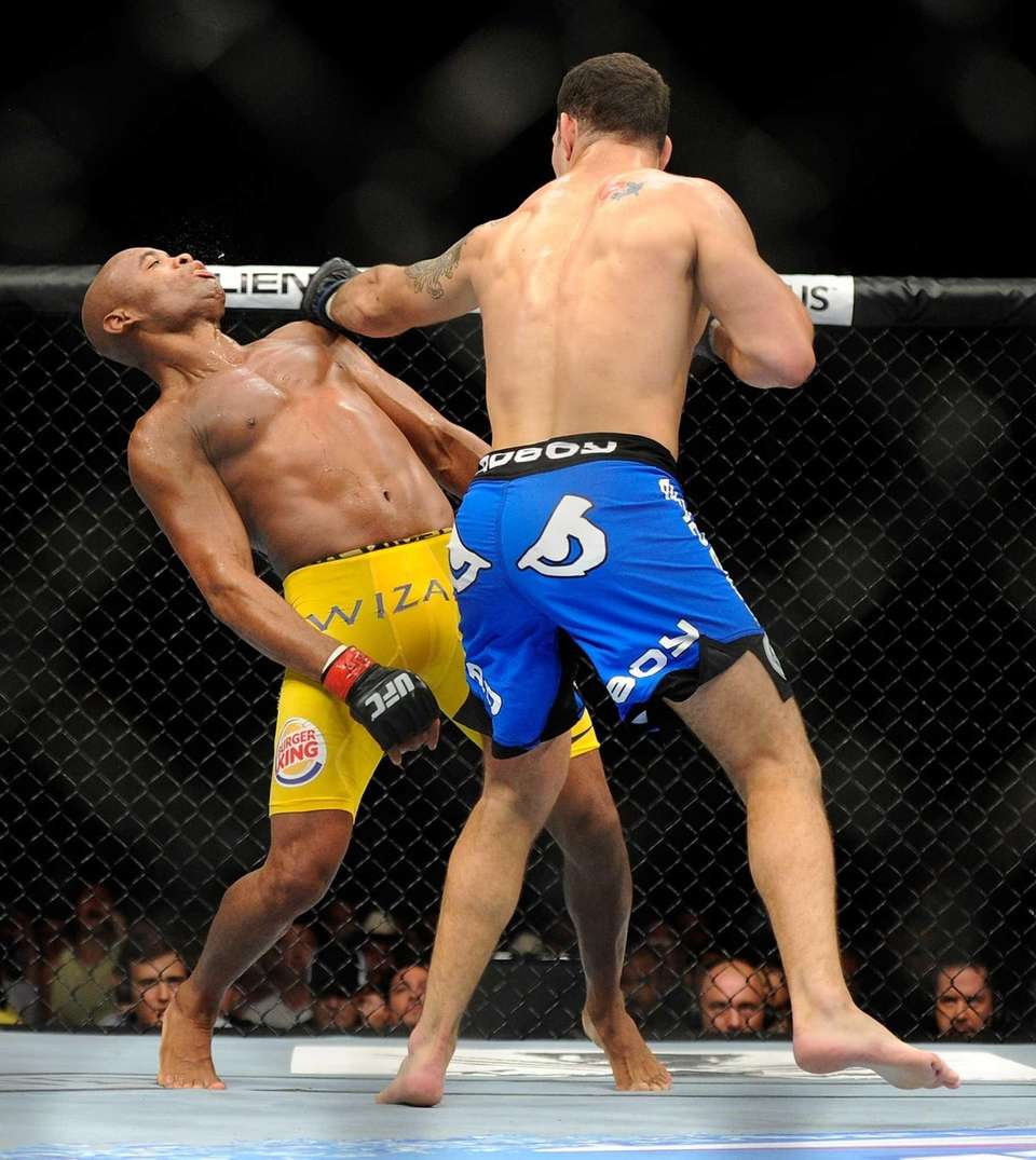 Chris Weidman connects with Anderson Silva during the