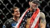 Chris Weidman, right, reacts after defeating Anderson Silva