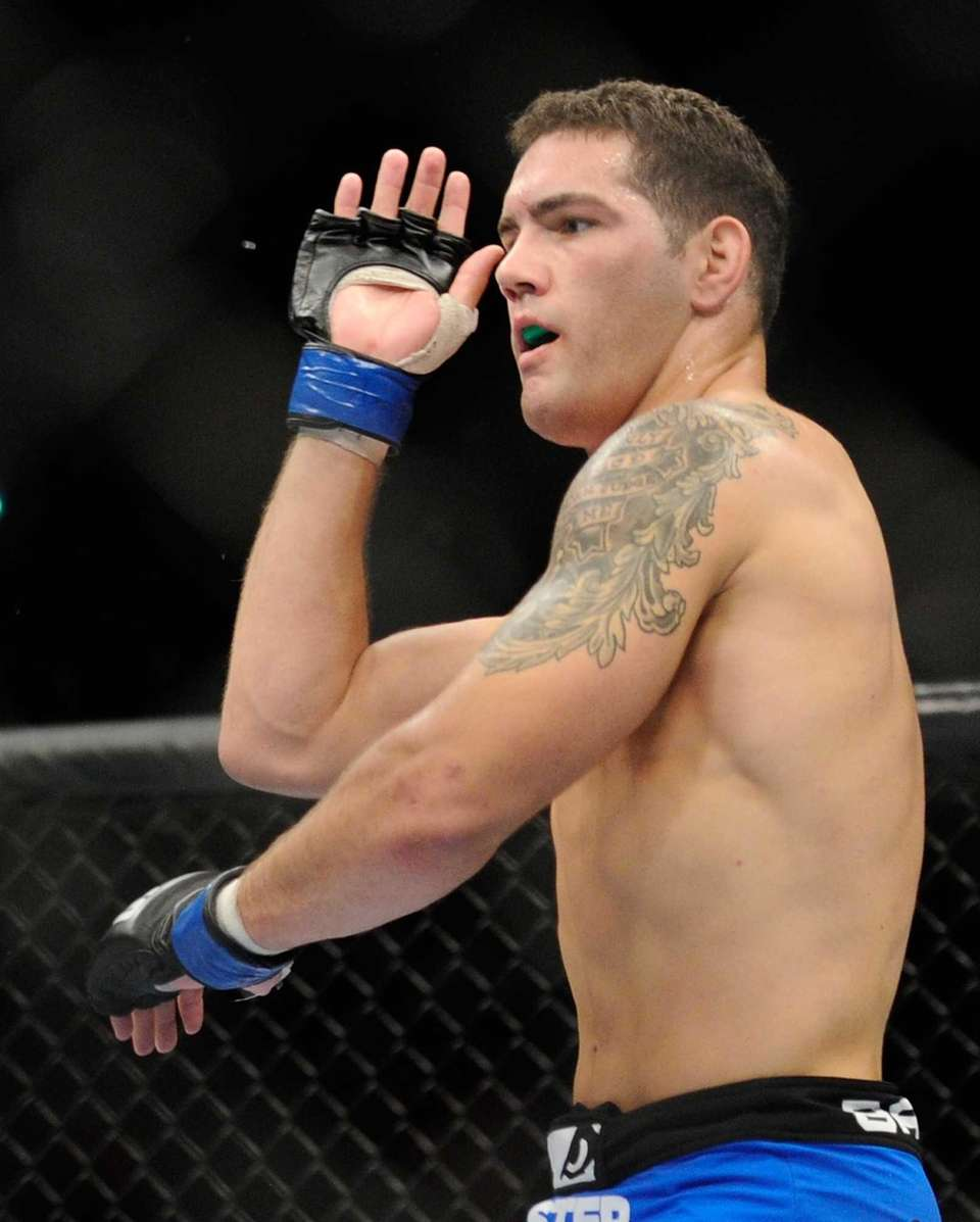 Chris Weidman protects himself during his UFC 162