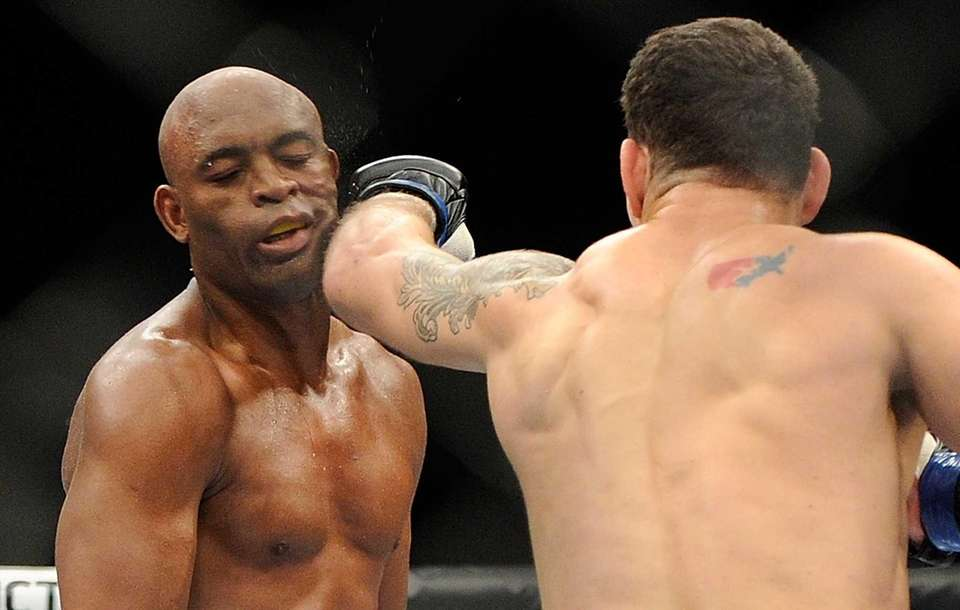 Chris Weidman connects with Anderson Silva during their