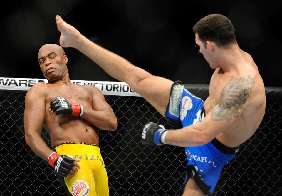 Chris Weidman kicks Anderson Silva during their UFC