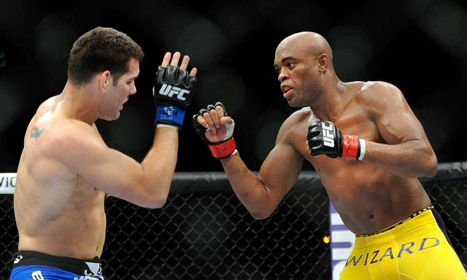 Chris Weidman, left, and Anderson Silva battle it