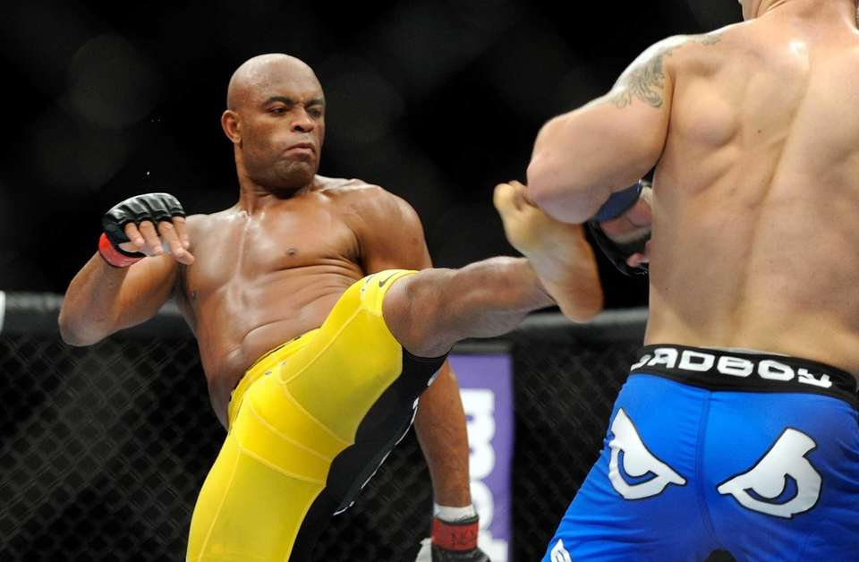 Anderson Silva kicks Chris Weidman during their UFC