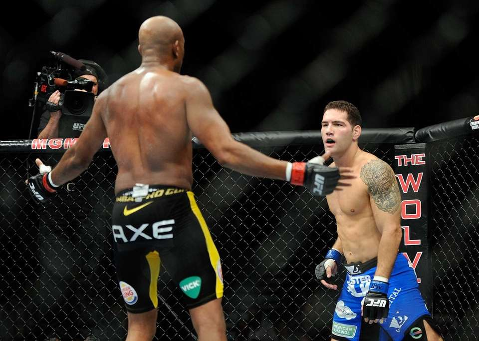 Anderson Silva, left, taunts Chris Weidman during their