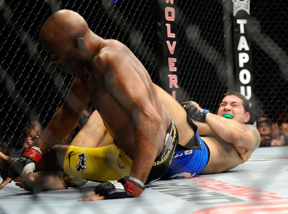 Chris Weidman, right, and Anderson Silva battle it