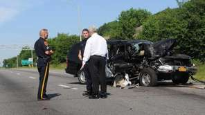 Investigators are seen at an accident scene where