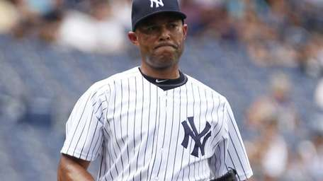 Mariano Rivera reacts after giving up a double